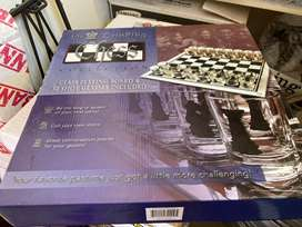 Glass playing chess board and 32 shot glasses