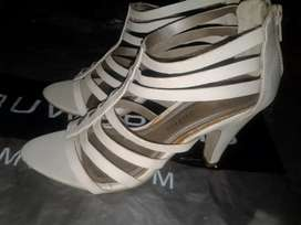 Cream colour high heel shoe