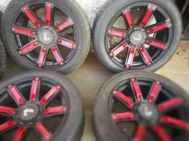 A set of 6 holes 4x4 mags and Tyres 20 inch