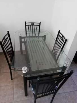 Dinning table with glass top. Including 4 chairs.