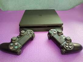 PS4 SLIM 2 CONTROLLERS WITH FOUR GAMES 1 TB WITH CABLES 1 MONTH OLD