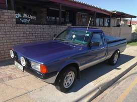 3.4 V6 with 5 speed Cressida gearbox.