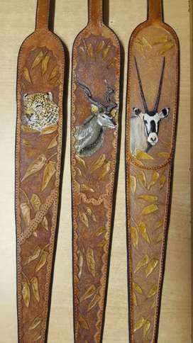 Leather gun slings with animal printing on it