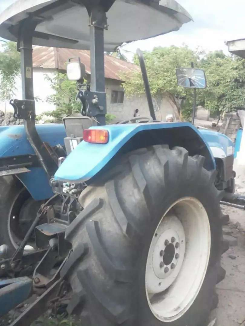 Tractor including bucket, harrow and blade for as cool as Ghc75000 0