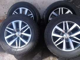 A set of 18 inch Toyota 4x4 mag rims and tyres