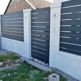 GALVANIZED STEEL FRAMED NUTED SLATED FENCING AND DRIVEWAY GATES