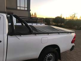 Toyota Hilux roll bar and tone-cover