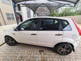 A white in good shape ford figo looking for a new owner.