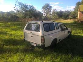 white bakkie with canopy in driving condition