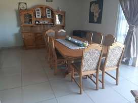 10 seater oak table with chairs and sideboard