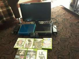 2x Xbox 360, wireless remote, LG flat screen, 7 games