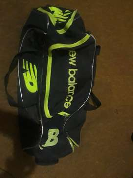 BS cricket bat and new balance cricket bag
