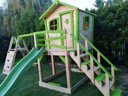 Plac zabaw dla dzieci domek huśtawka meble ogrodowe ślizgawka.