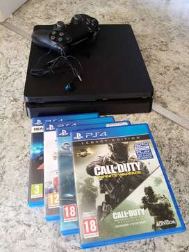 Playstation 4 Jet Black 1 TB memory with 1 controller and 4 games
