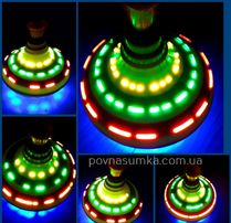 Disco юла!муз,свет,меняет изображение,крутится долго!музыкальная юла