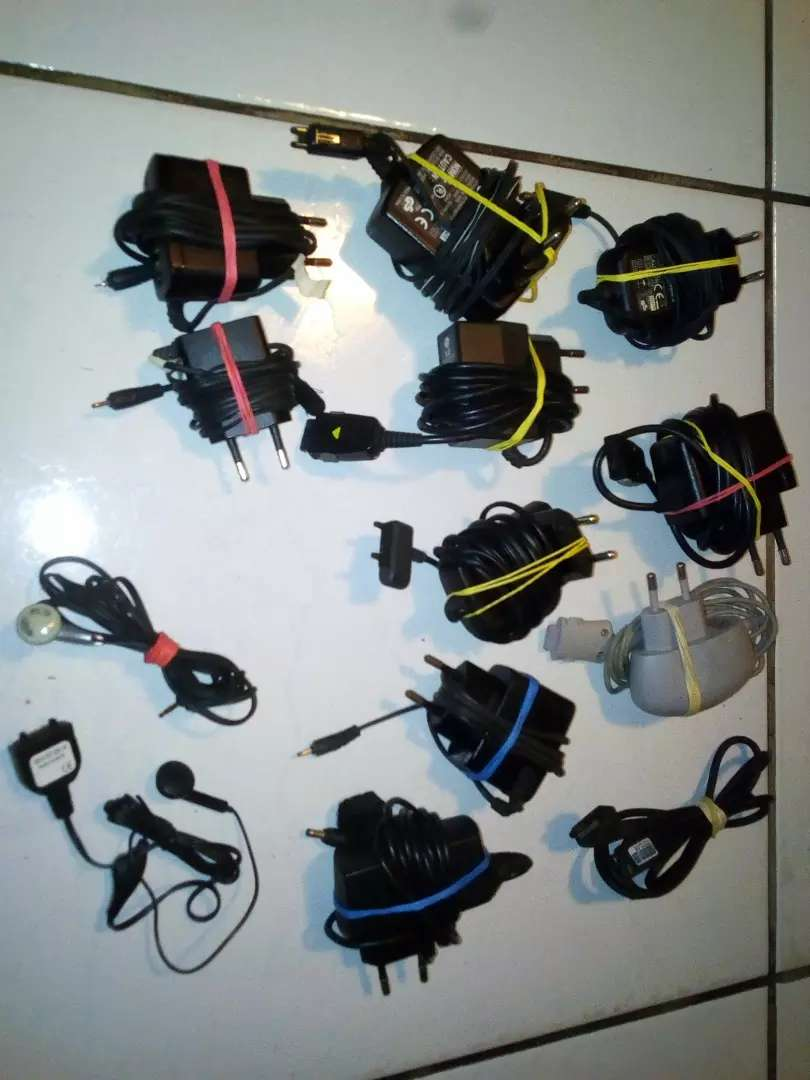 Old cellphone chargers & headphones (R100 each) 0