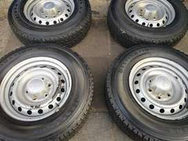 A set of 16 inch rims and tyres for Isuzu