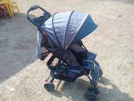 Cot is brand new never neen used and a second hand pram with it.
