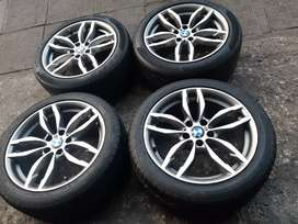 """A set of 19"""" BMW rims and tyres at 75% thread tyres"""