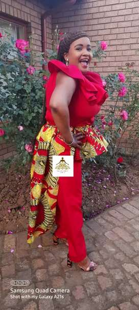 Red jumpsuit with Ankara tail
