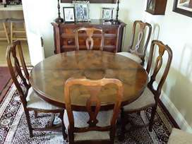 Great value. Mahogany wood dining table set with 6 matching chairs.