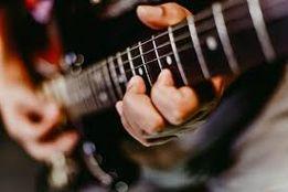 Уроки гри на гітарі/Уроки игры на гитаре