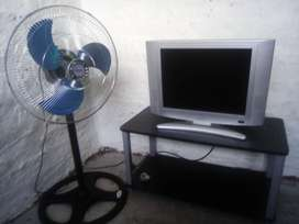 Kolin tv,tv stand and a fan