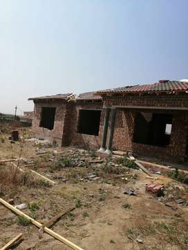 It is a face brick house, with tile roof,