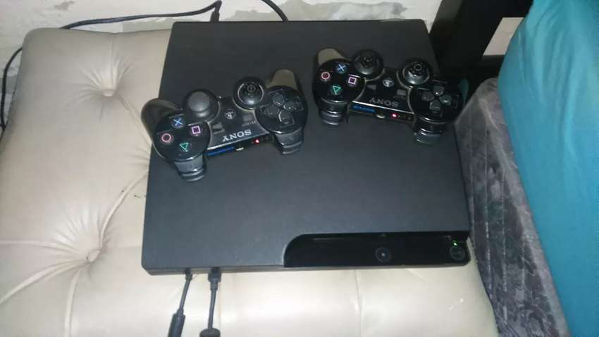 PS3 with two games and two controllers 0
