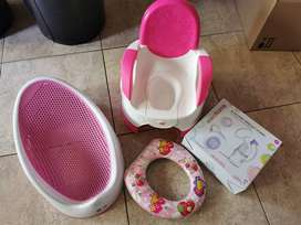 Electric breast pump, potty, bath seat and toddler seat combo.
