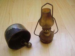 Stary dzwonek oraz lampka naftowa