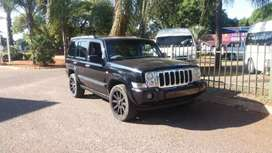 Jeep Commander 4.7 V8 lady owner on the road with papers