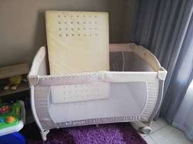 Bounce camp cot with mattress and a marching car seat