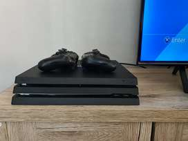 Sony Ps4 Pro console   2x Controllers   2x Games