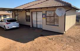Three bedroomed house one with ensuite,  kitchen and lounge, geyser