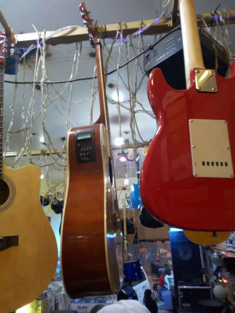 Amplified acoustic guitar 0