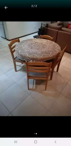 4 chairs and a wooden table