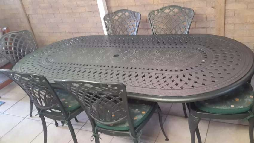 Cast iron table and 8 chairs 0