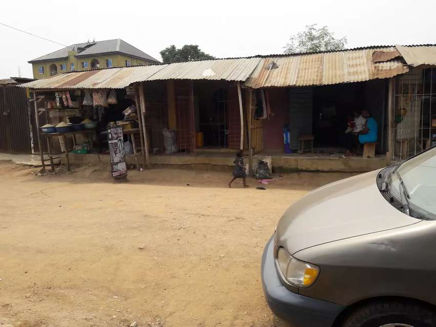 Full plot containing two bedroom flat and 1 room apartment with 4 shop 0